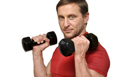Man  with a dumbells Stock Images