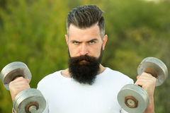 Man with dumbells Royalty Free Stock Photos