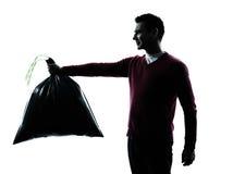 Man dumping garbage bag Stock Photo
