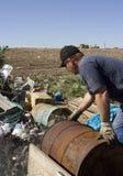 Man dumping trash. At landfill royalty free stock photography