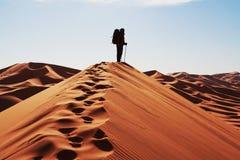 Man on dune Stock Photo