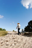 Man in dunes. Stock Photography