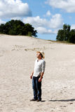 Man in dunes. Royalty Free Stock Photo