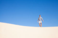 Man in dunes Stock Images