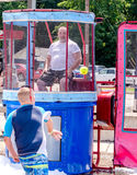 Man in a dunk tank at event Stock Images