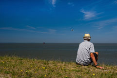 Man at Dutch wadden sea Royalty Free Stock Photos