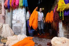 Man dyeing fabric in a market. Unknown man dyeing fabric in a market (souk), July 09, 2013 in a Marrakesh, Morocco. The market is one of the most important stock photo