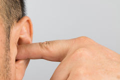 Man ear. Man cover your ears with your fingers Royalty Free Stock Image