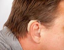 Man ear with hearing aid Stock Photos