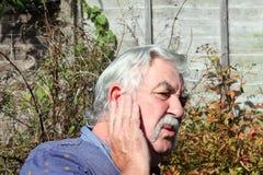 Man with an earache. Royalty Free Stock Photo