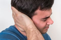 Man with earache is holding his aching ear Stock Image