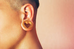 Man with earlobe hole. Royalty Free Stock Photos