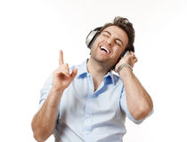 Man with earphones Stock Images