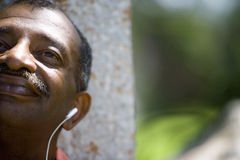 Man with earphones, close-up Royalty Free Stock Images