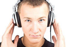 Man with earphones listening to music Royalty Free Stock Photography