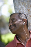 Man with earphones outdoors, close-up Stock Photo