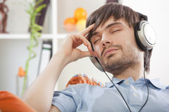 Man in earphones relaxing Royalty Free Stock Photo