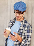 Man with earphones and smartphone drinking coffee Stock Photo