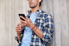 Man with earphones and smartphone listening music Royalty Free Stock Images
