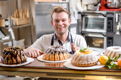Man with Easter cakes Stock Photography