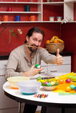 Man with Easter eggs holding up thumb Royalty Free Stock Photography