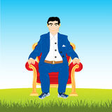 Man in easy chair on glade Royalty Free Stock Images