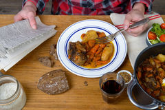 A man eat beef carrot Stock Image