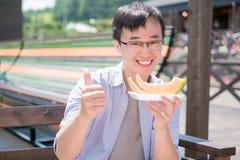 Man eat cantaloupe stock photo