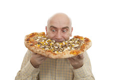 Man eat pizza. Glutton eat big pizza on white background Royalty Free Stock Photo