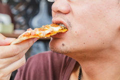 Man eat pizza Stock Photo