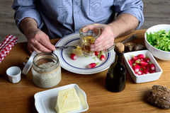 A man eat radishes with butter and drink cider Royalty Free Stock Photography