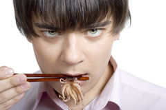 Man eat squid Royalty Free Stock Photography