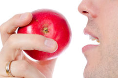 Man Eating A Red Apple Stock Photo