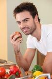Man eating an apple Royalty Free Stock Photo