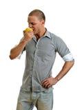 Man eating an apple. stock photography