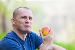 Man eating an apple outdoor Stock Photography