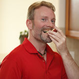Man Eating Apple Slice Royalty Free Stock Images