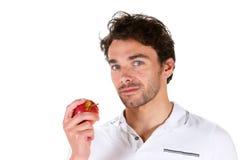 Man eating an apple Stock Photography