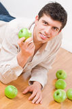 Man eating apples Stock Photography