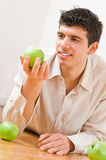 Man eating apples Stock Photo