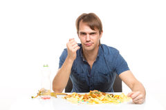 Man eating a banana. on the table a lot of dirt Stock Images