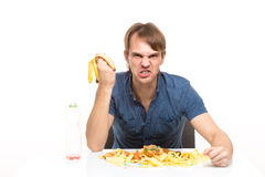 Man eating a banana. on the table a lot of dirt Royalty Free Stock Images