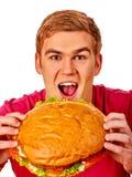 Man eating big sandwich. Stock Photo