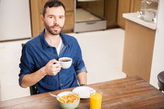 Man eating breakfast alone at home Stock Photo