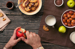 Man eating breakfast cookies with milk and apples Stock Photo