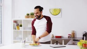Man eating breakfast and dancing at home stock video