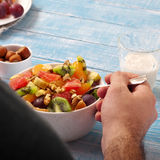 Man eating breakfast fruit salad Royalty Free Stock Image