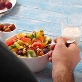 Man eating breakfast fruit salad Royalty Free Stock Image