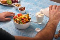 Man eating breakfast fruit salad with yogurt Stock Photography