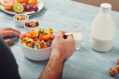 Man eating breakfast fruit salad with yogurt Royalty Free Stock Photos